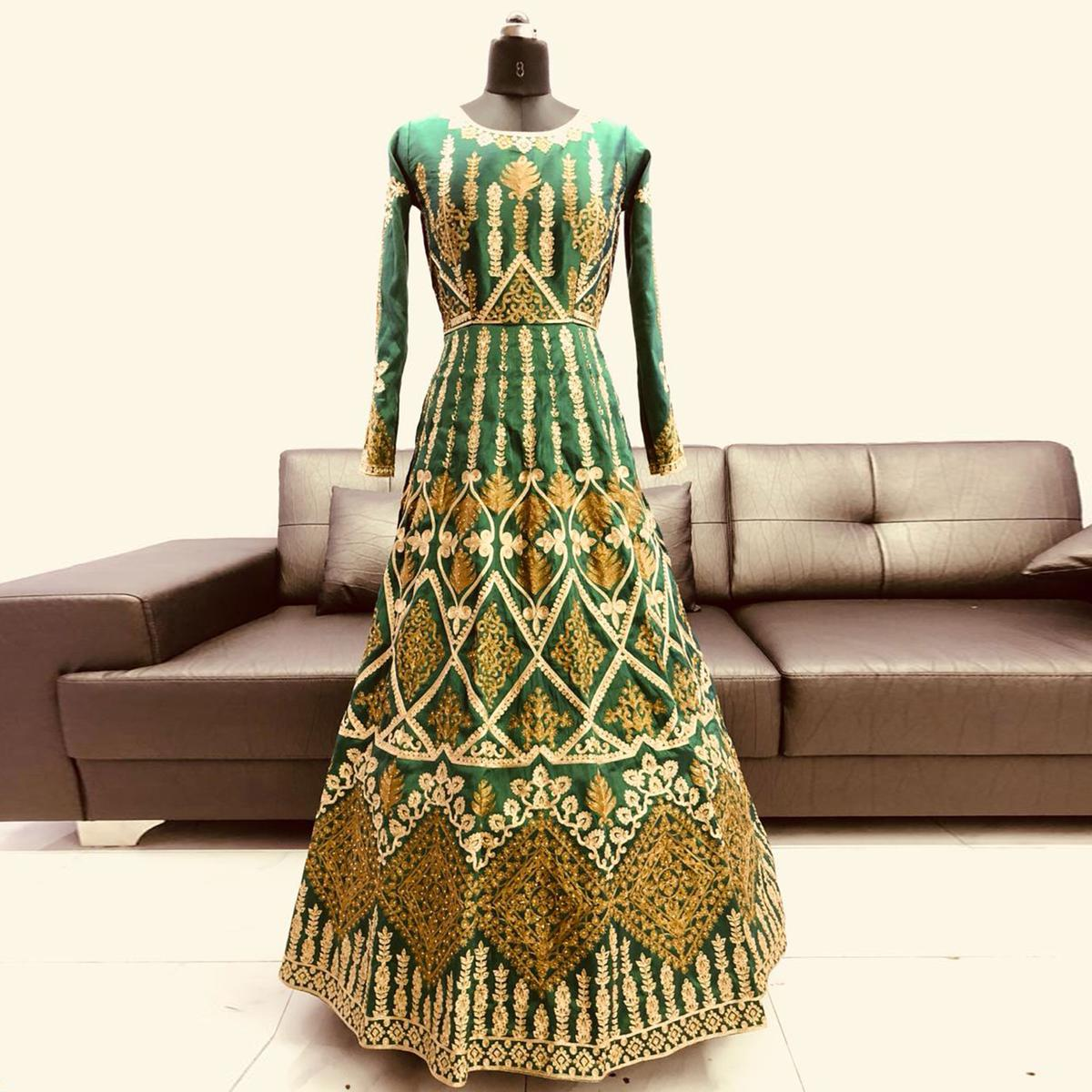 Stunning Green Colored Partywear Embroidered Mulberry Silk Anarkali Suit