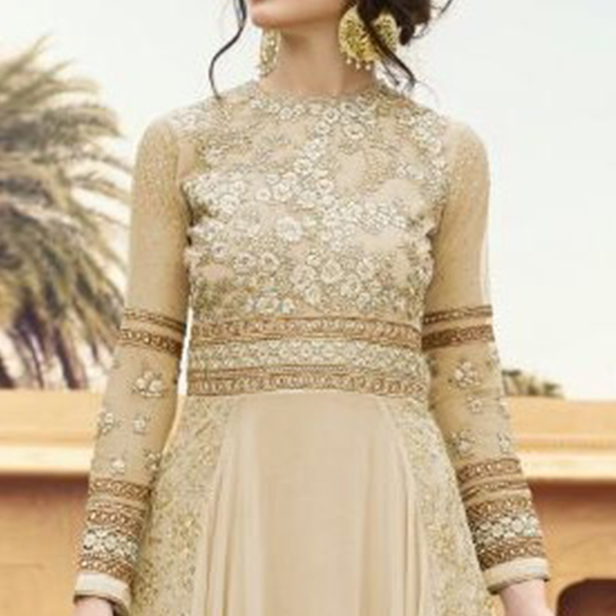 Unique Cream Colored Party Wear Embroidered Georgette Anarkali Suit