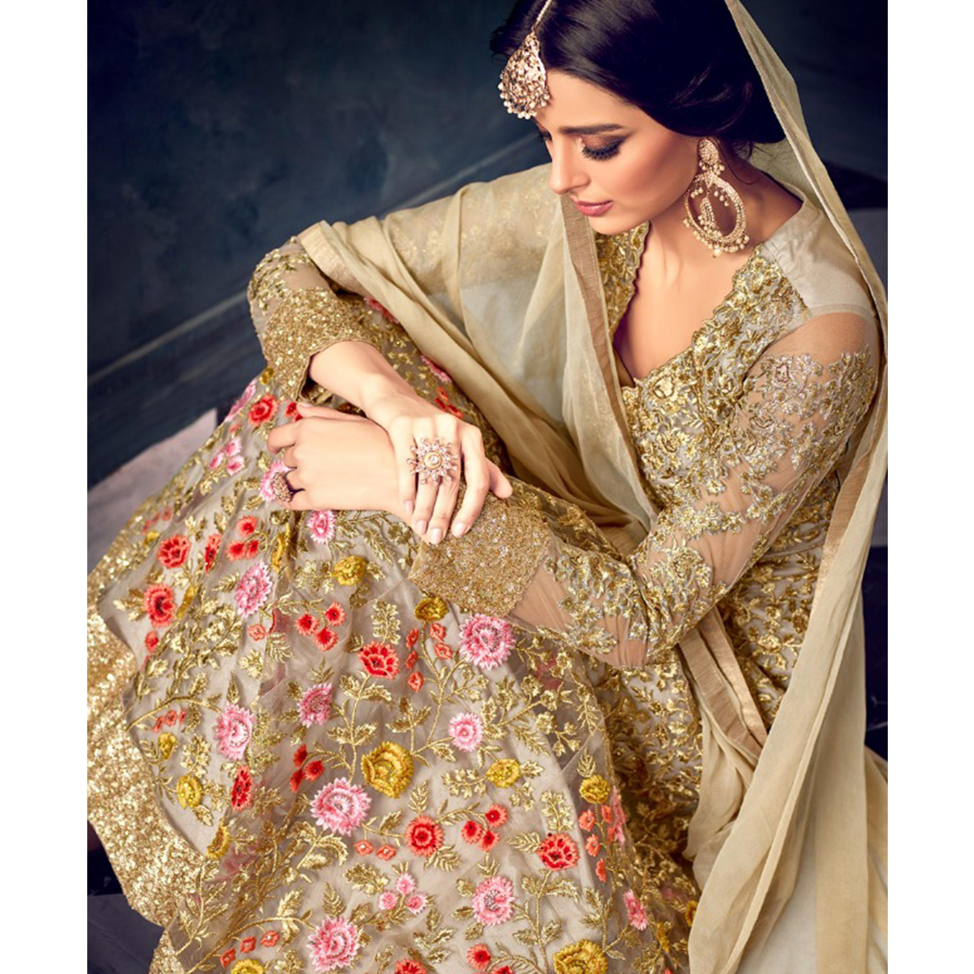 Fabulous Golden Colored Partywear Embroidered Netted Anarkali Suit