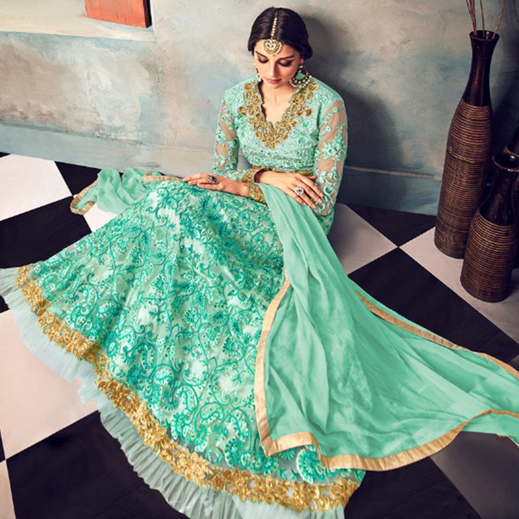 Refreshing Aqua Blue Colored Partywear Embroidered Netted Anarkali Suit