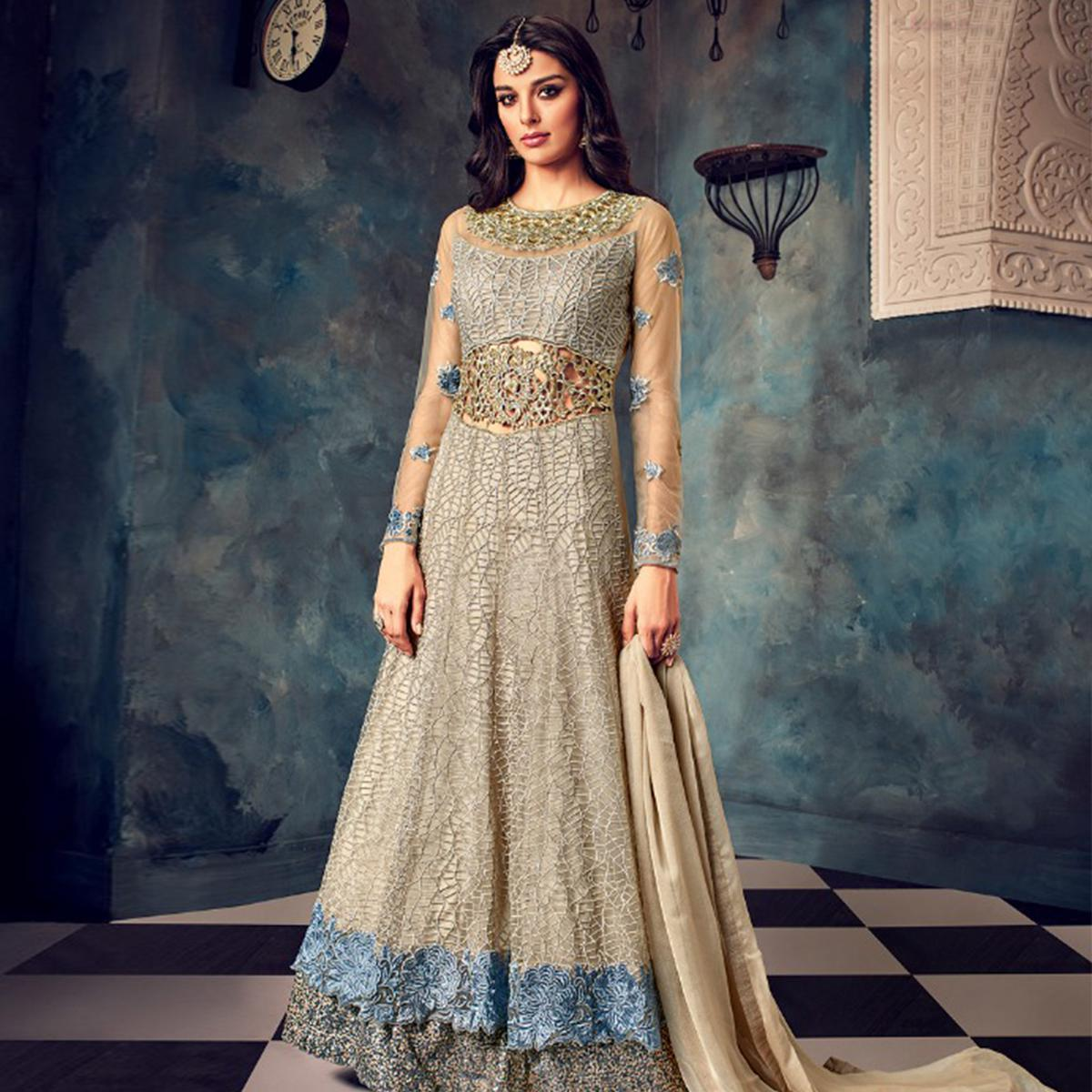 Amazing Gray Colored Partywear Embroidered Netted Anarkali Suit
