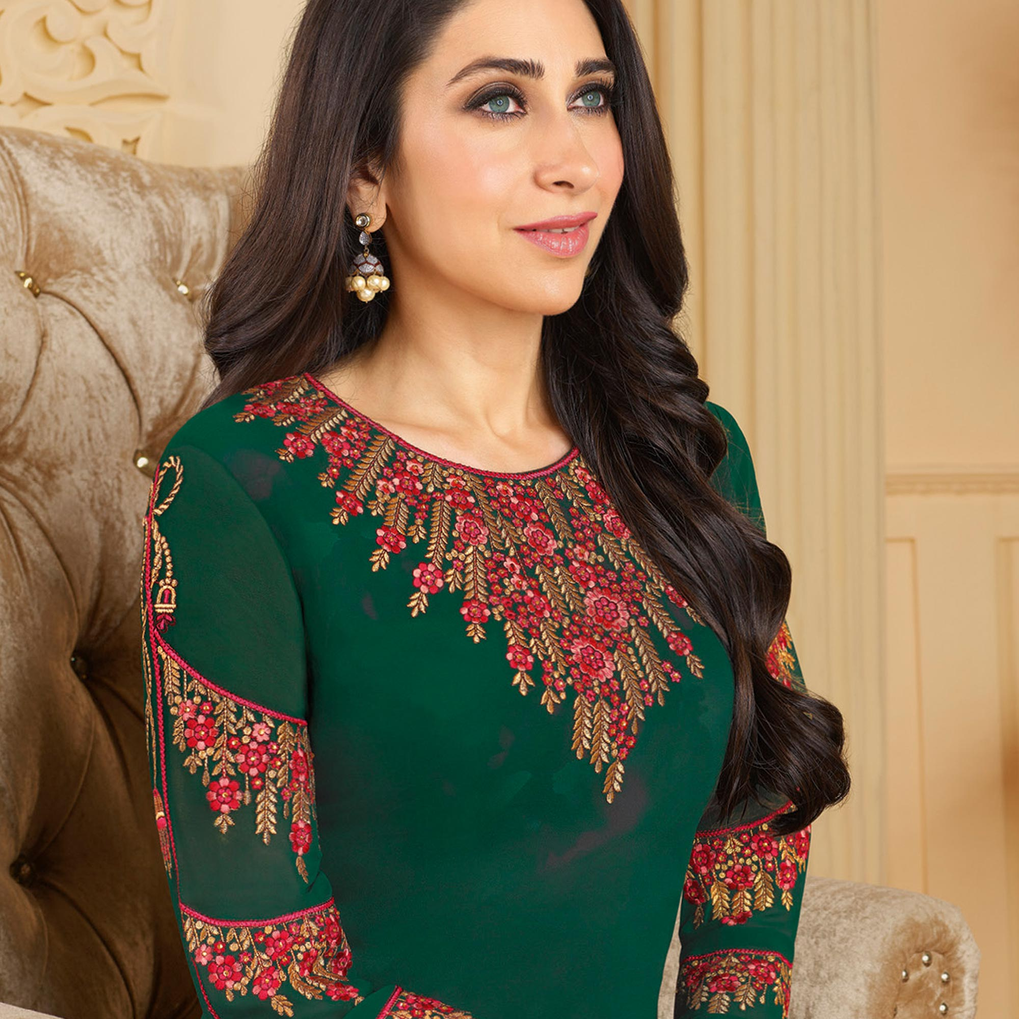 Stunning Dark Green Colored Partywear Embroidered Georgette Palazzo Suit