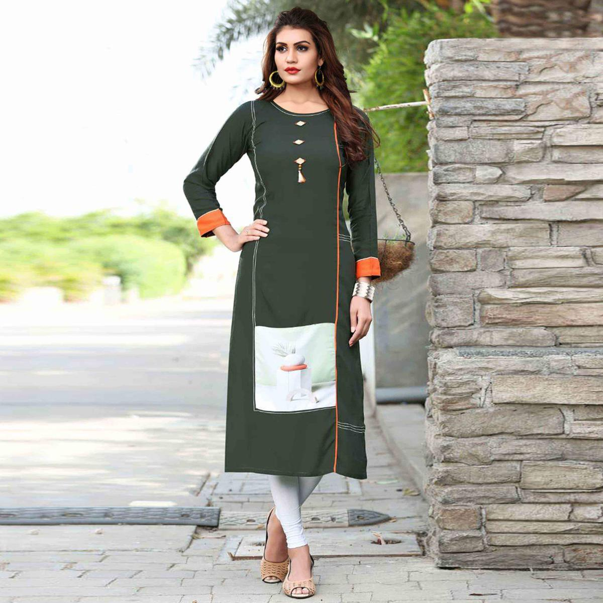 Staring Olive Green Colored Casual Printed Rayon Kurti