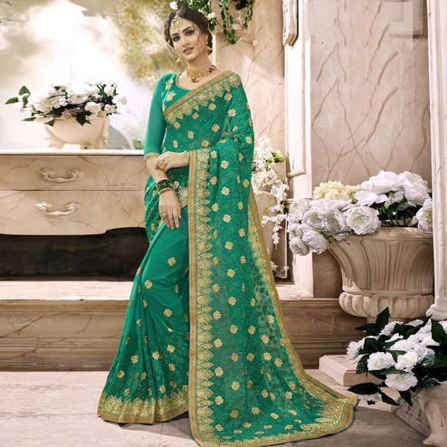Gleaming Turquoise Green Colored Partywear Embroidered Faux Georgette Saree
