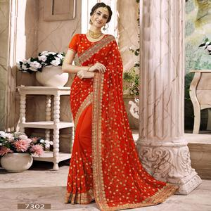 Beautiful Orange Colored Partywear Embroidered Faux Georgette Saree
