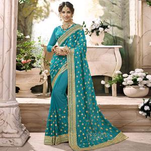 Adorning Sky Blue Colored Partywear Embroidered Faux Georgette Saree