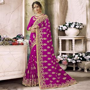 Magnetic Magenta Colored Partywear Embroidered Faux Georgette Saree