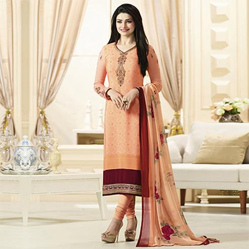 Attractive Light Orange Designer Embroidered Crepe Salwar Suit