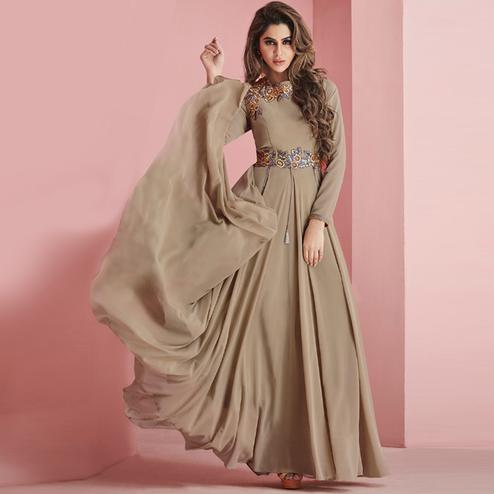 Hypnotic Gray Colored Partywear Embroidered Faux Georgette Gown