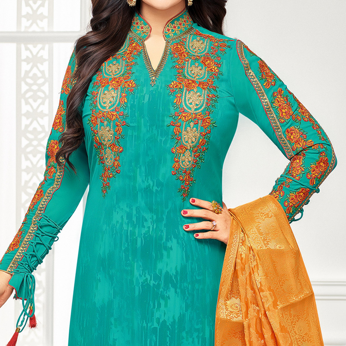 Pleasant Turquoise Green Colored Embroidered Party Wear Georgette Salwar Suit