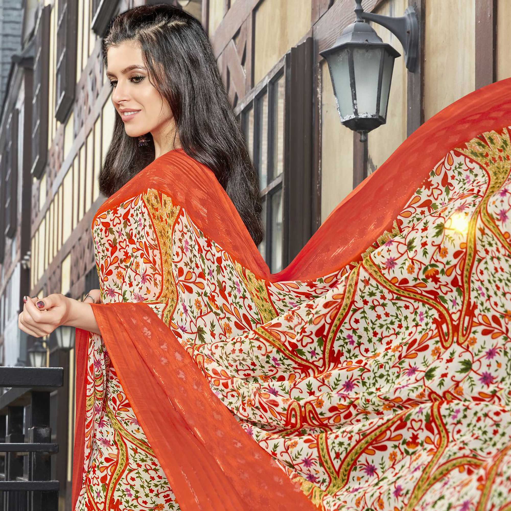 Trendy Orange Colored Casual Printed Georgette Saree