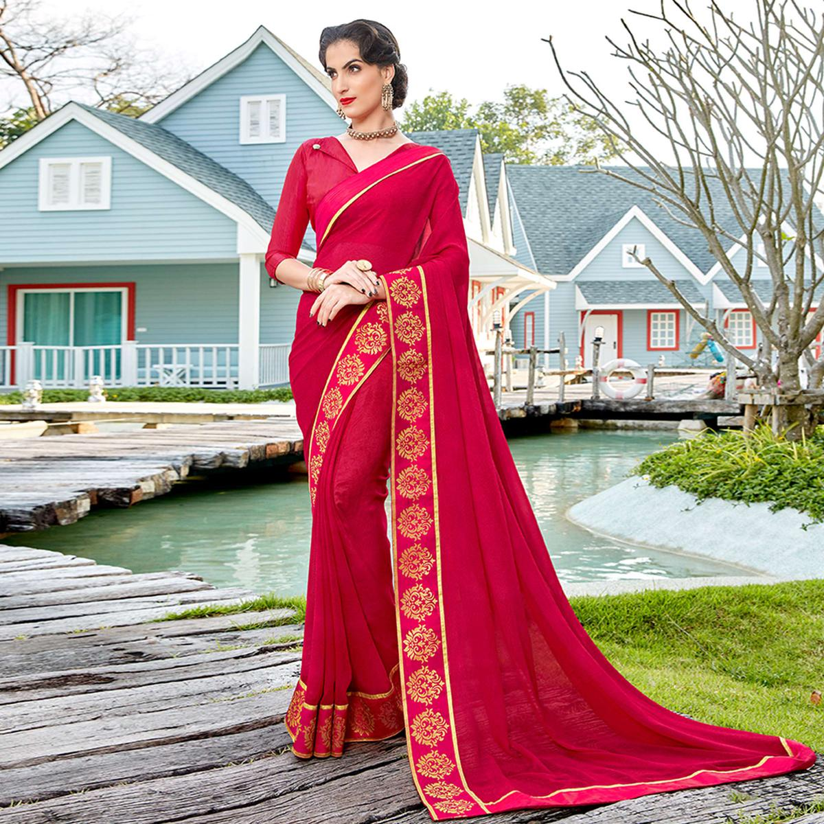 Stunning Pink Colored Casual Printed Georgette Saree