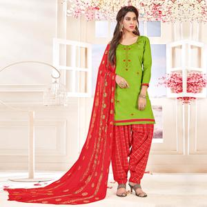 Amazing Green Colored Partywear Embroidered Cotton Dress Material