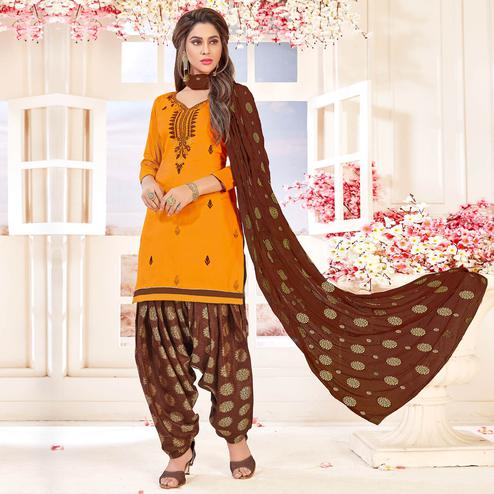 Beautiful Mango Yellow Colored Partywear Embroidered Cotton Dress Material