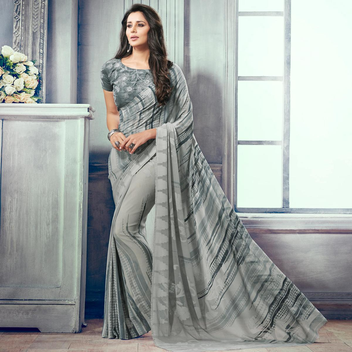 Charming Grey Colored Party Wear Printed Brasso Saree