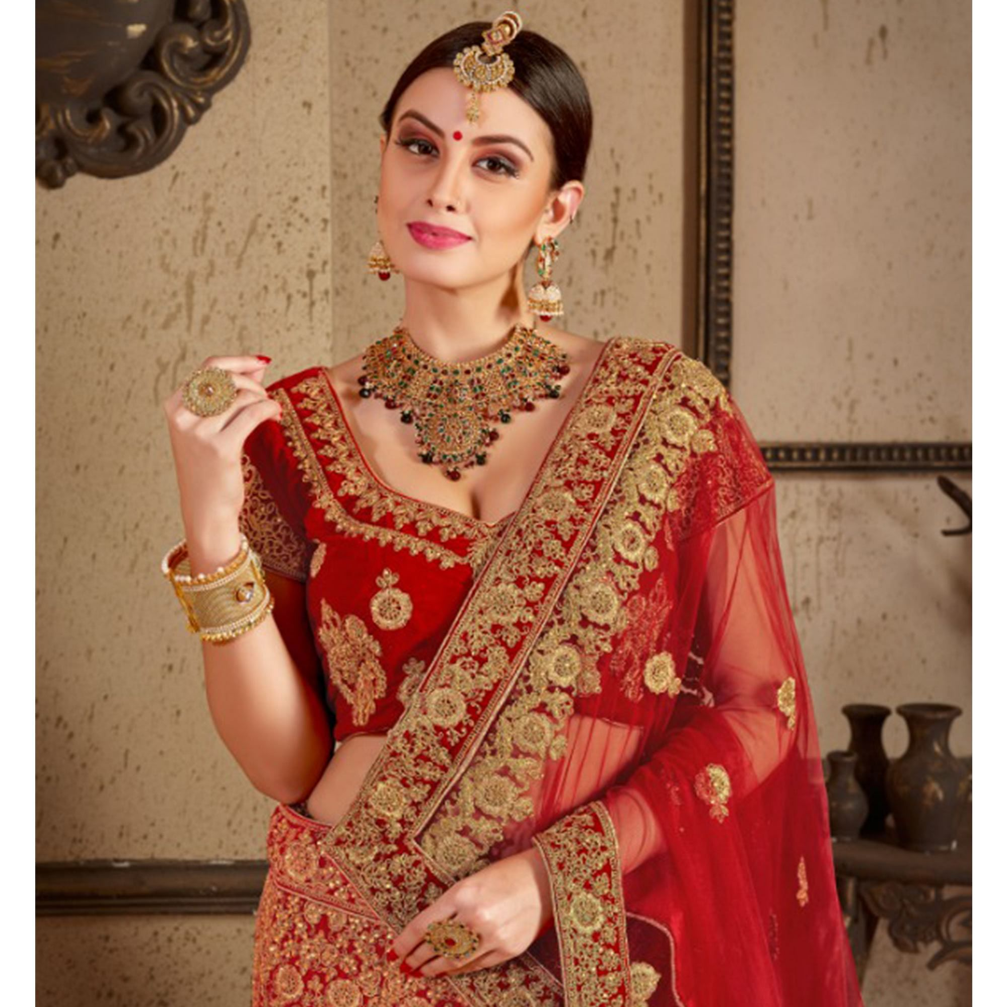 Prominent Red Colored Wedding Wear Embroidered Velvet Lehenga Choli
