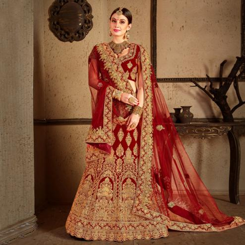 Glowing Maroon Colored Wedding Wear Embroidered Velvet Lehenga Choli