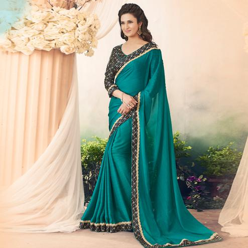 Eye-Catching Teal Green Colored Casual Printed Art Silk Saree