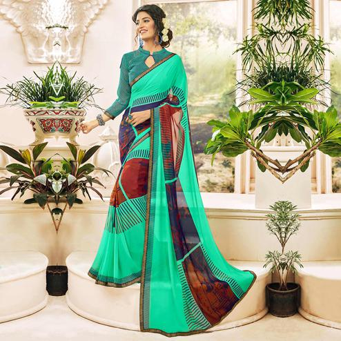 Refreshing Sea Green Colored Casual Wear Printed Georgette Saree
