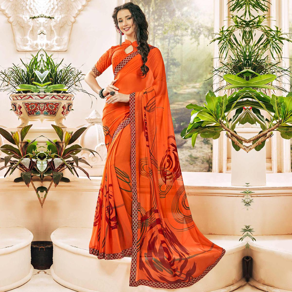 Alluring Orange Colored Casual Wear Printed Georgette Saree