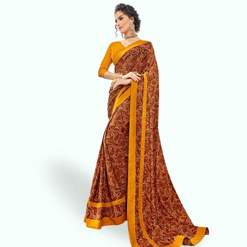 Unique Brown-Orange Colored Casual Printed Crepe Saree