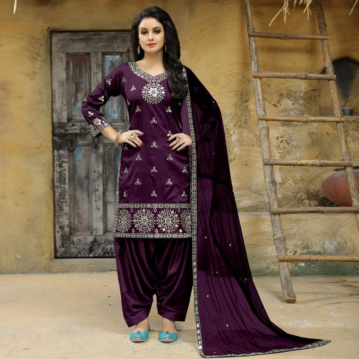 Elegant Purple Colored Party Wear Embroidered Tapetta Silk Suit