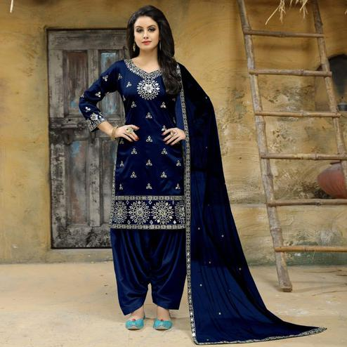 Alluring Navy Blue Colored Party Wear Embroidered Tapetta Silk Suit