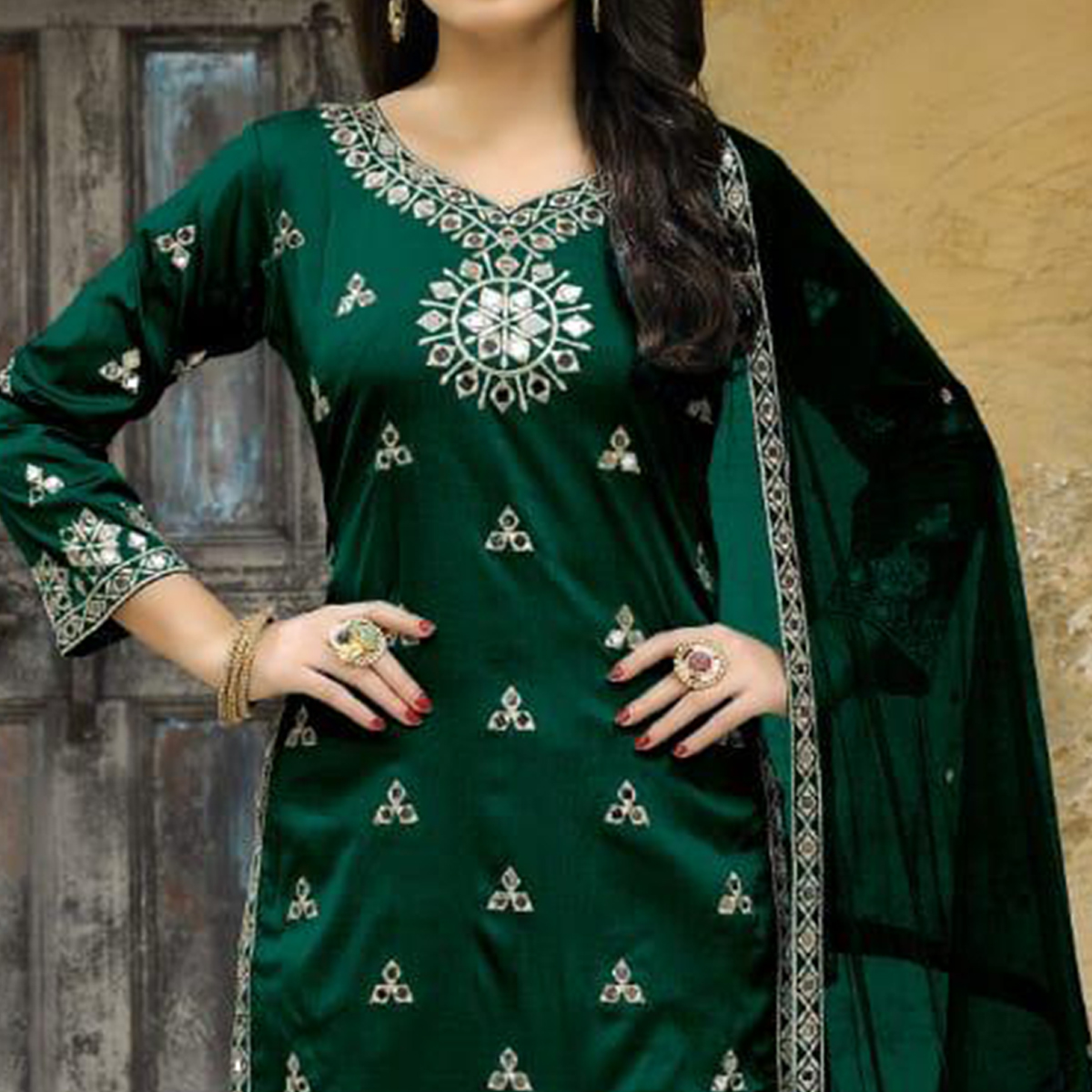 Sensational Green Colored Party Wear Embroidered Tapetta Silk Suit