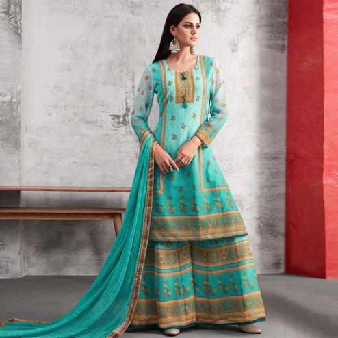 Surpassing Aqua Blue Colored Party Wear Printed Georgette Palazzo Suit