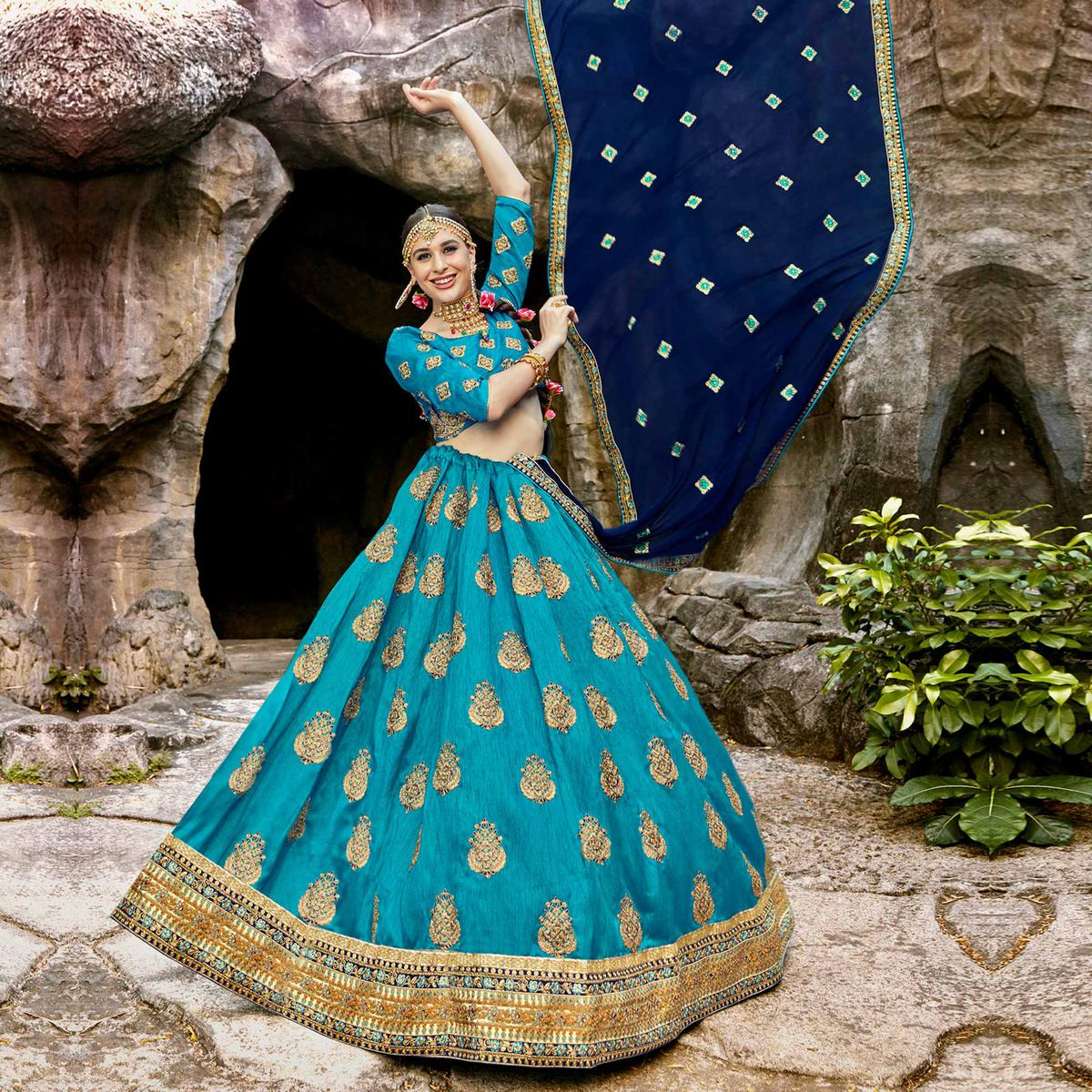 Gorgeous Sky Blue Colored Partywear Embroidered Raw Silk Lehenga Choli
