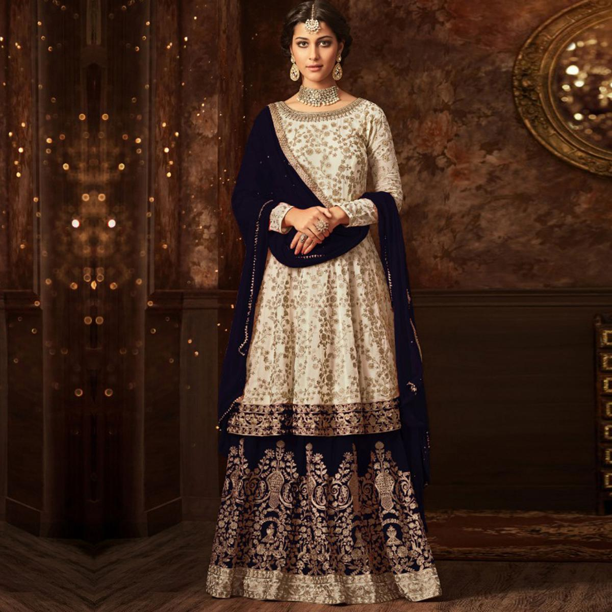 Hypnotic White-Navy Blue Colored Partywear Embroidered Georgette Palazzo Suit