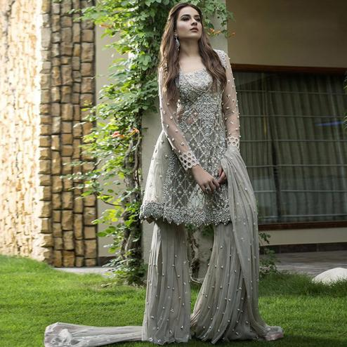 Stunning Gray Colored Partywear Embroidered Netted Palazzo Suit