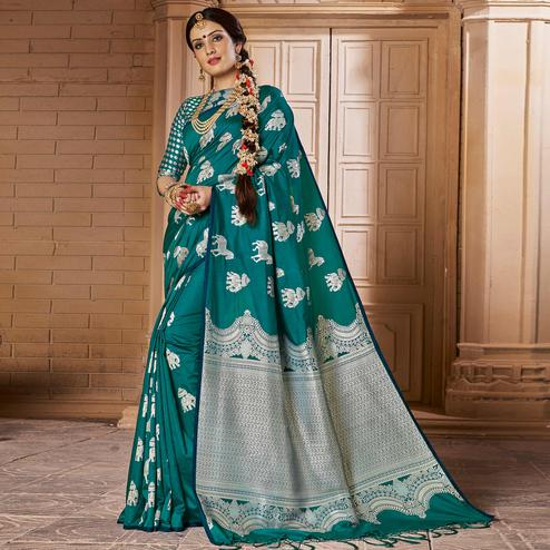 Hypnotic Teal Blue Colored Festive Wear Woven Silk Saree