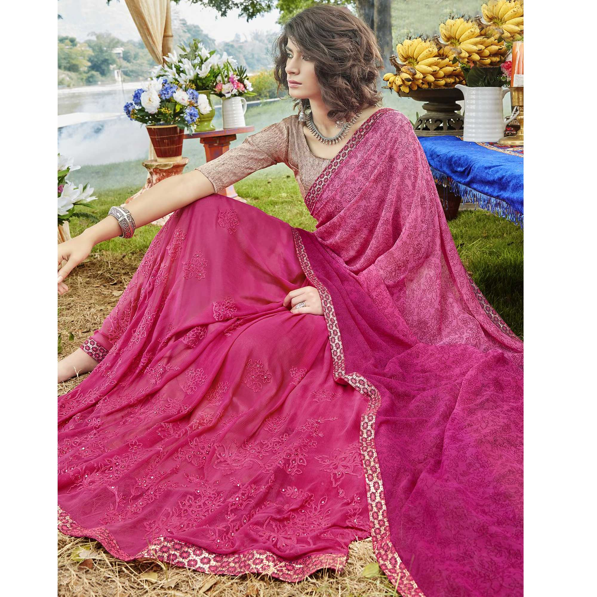 Charming Pink Colored Partywear Embroidered Faux Georgette Saree