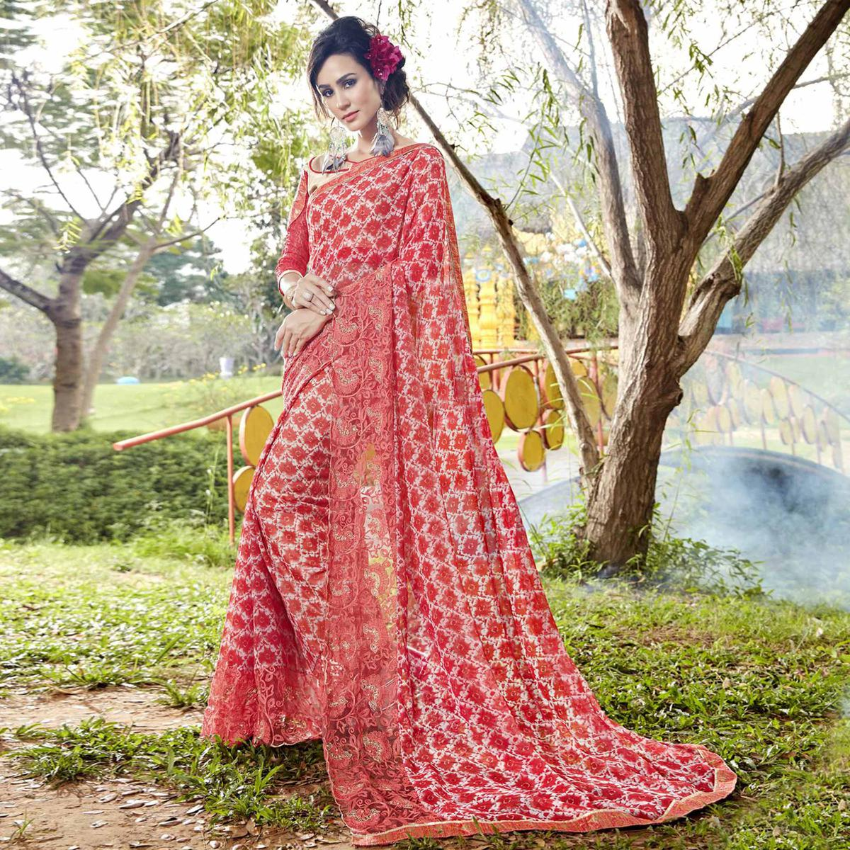 Stunning Red Colored Partywear Printed Faux Georgette Saree