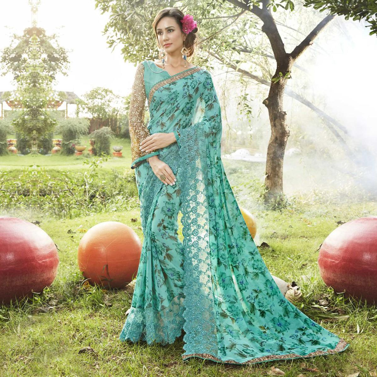 Stylish Aqua Blue Colored Partywear Printed Faux Georgette Saree