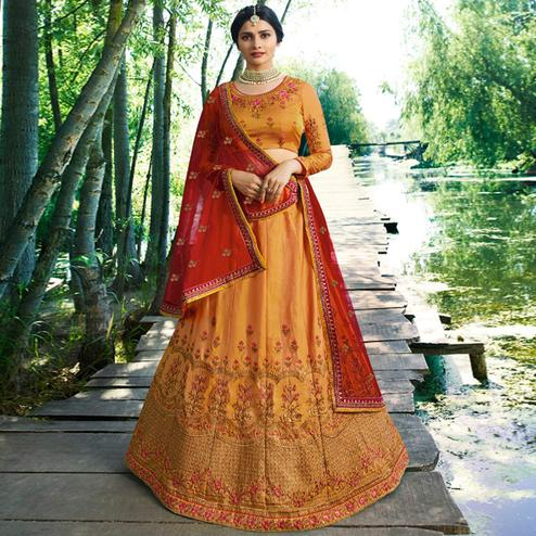 Prominent Orange Colored Wedding Wear Embroidered Silk Lehenga