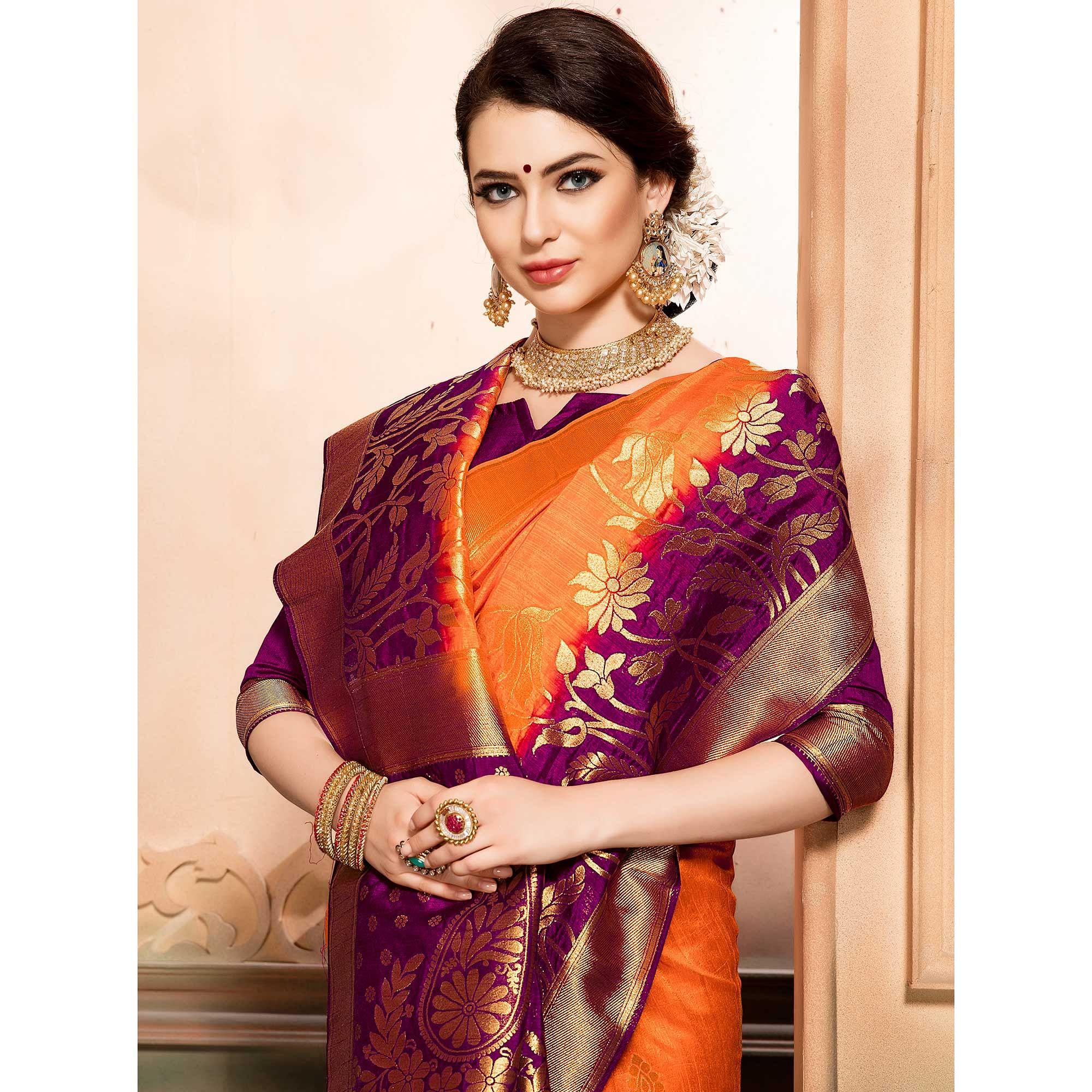 Opulent Orange Colored Festive Wear Woven Raw Silk Saree