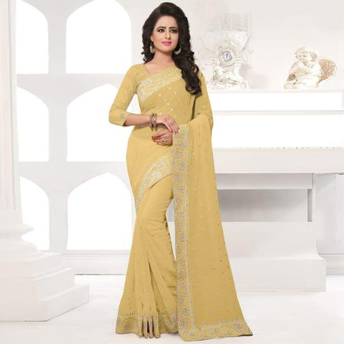 Mesmerising Beige Colored Party Wear Embroidered Georgette Saree