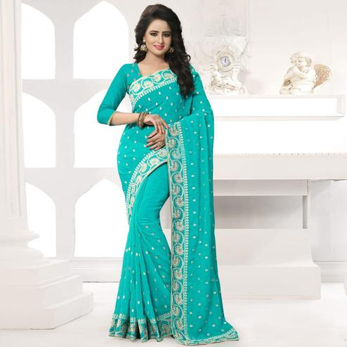 Eye-catching Turquoise Colored Party Wear Embroidered Georgette Saree