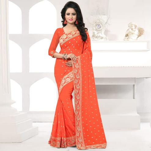 Amazing Orange Colored Party Wear Embroidered Georgette Saree