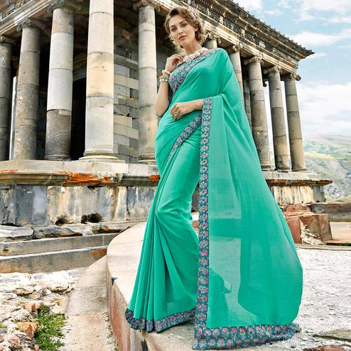 Arresting Turquoise Green Colored Casual Printed Chanderi Silk Saree