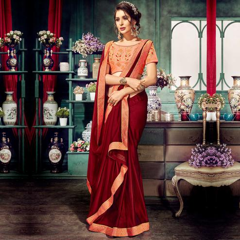 Stunning Maroon Colored Partywear Embroidered Georgette Saree