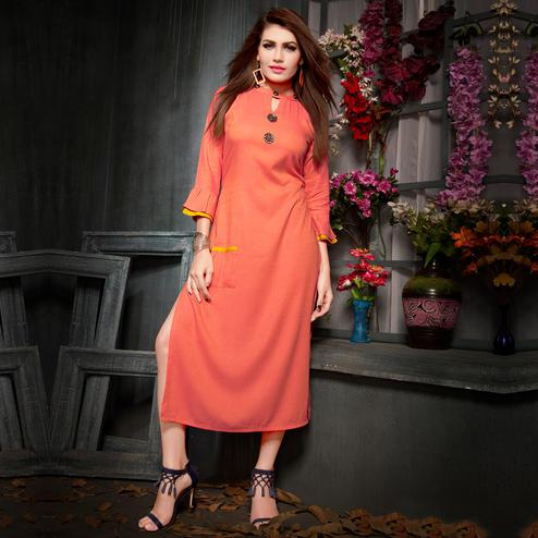 Pretty Peach Colored Party Wear Fancy Rayon Kurti