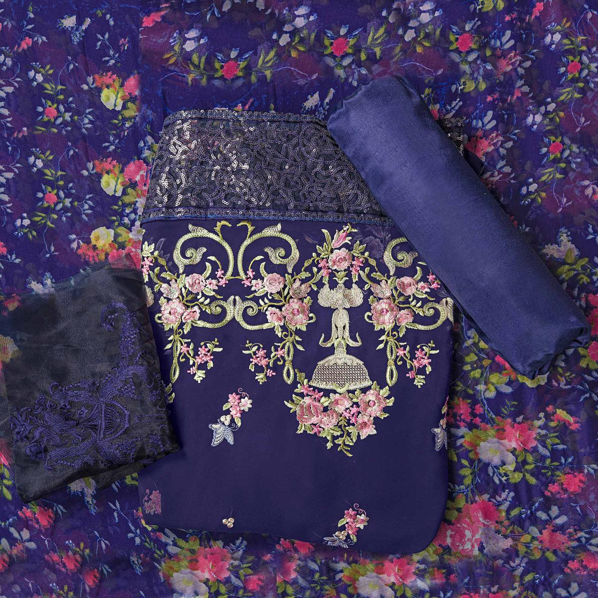 Beautiful Blue Colored Partywear Embroidered Faux Georgette Suit