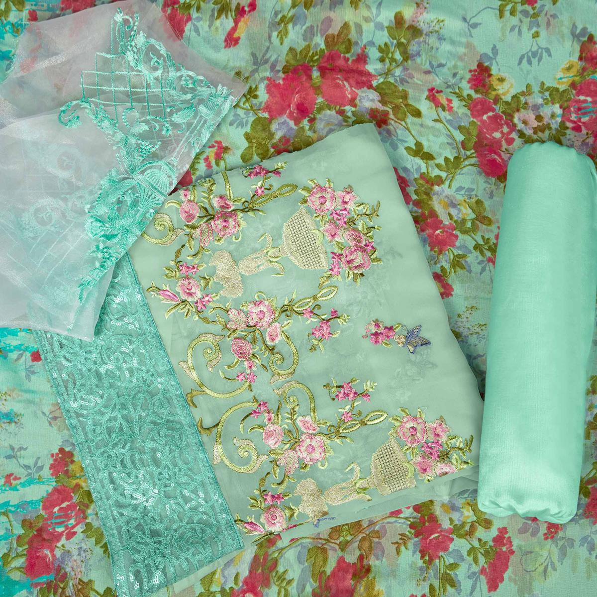 Refreshing Aqua Green Colored Partywear Embroidered Faux Georgette Suit