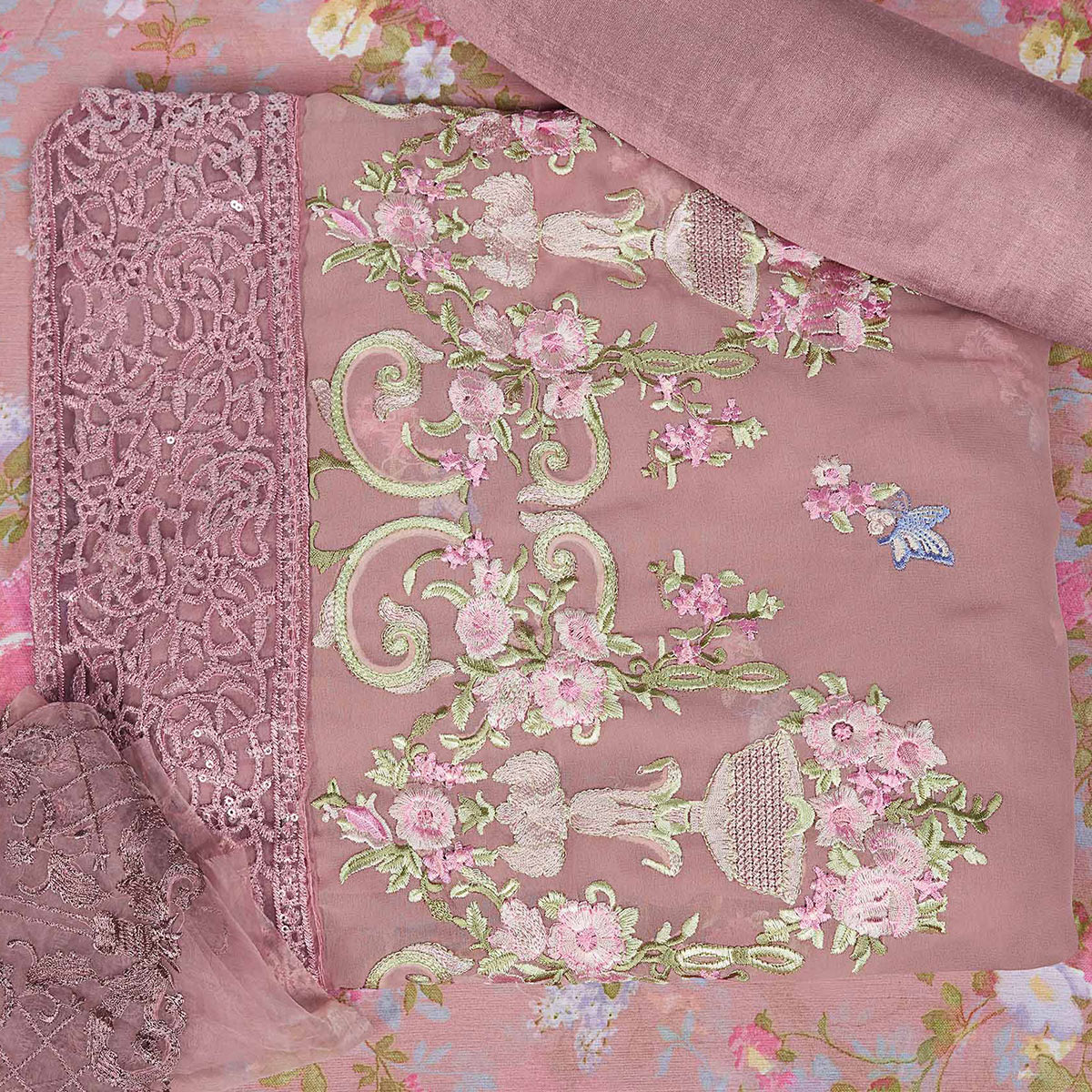 Hypnotic Mauve Colored Partywear Embroidered Faux Georgette Suit