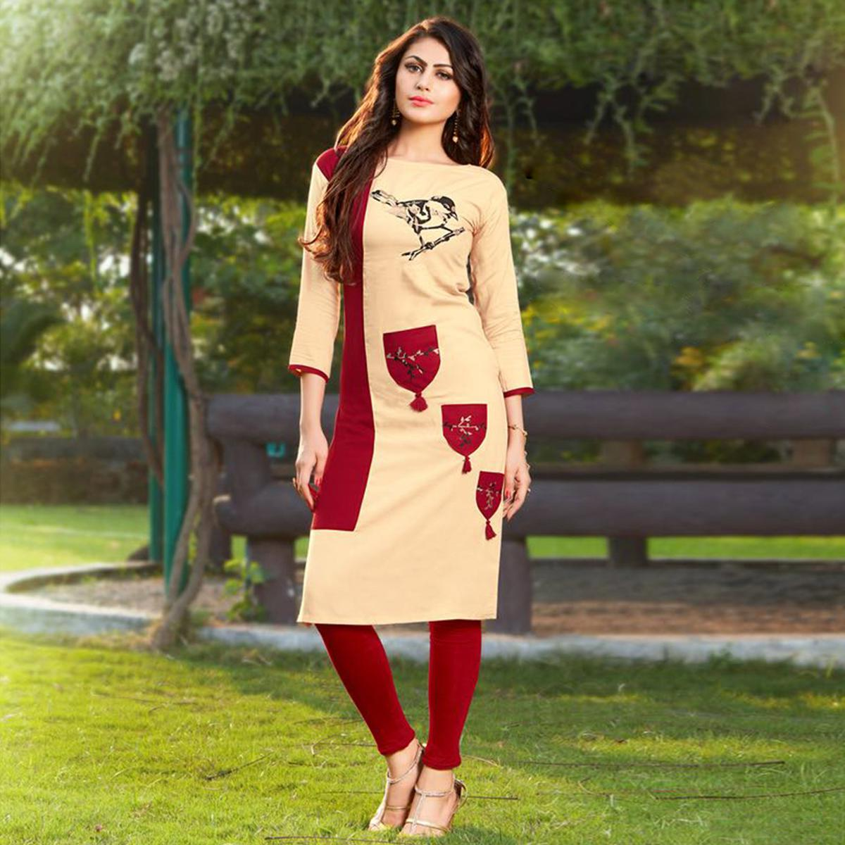 Appealing Cream-Maroon Colored Casual Printed Heavy Rayon Kurti