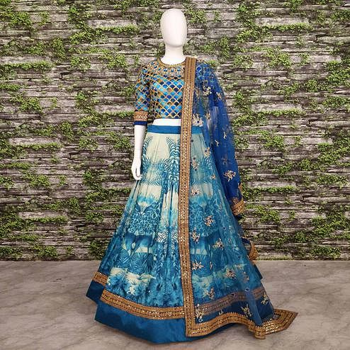 Hypnotic Blue Colored Partywear Embroidered Art Silk Lehenga Choli