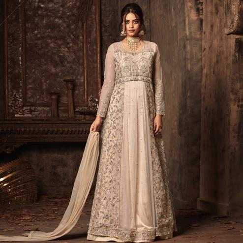 Charming Cream Colored Party Wear Embroidered Heavy Net Anarkali Suit